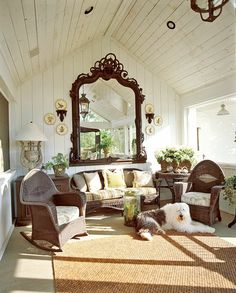 A massive antique mirror from Cincinnati dominates one end of the sleeping porch, which is furnished in a mix of old wicker pieces
