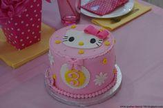 Pink white and yellow hello ketty cake