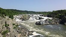 Great Falls Park on the Potomac River near DC -- there's a Maryland side and a Virginia side. The MD side includes the Great Falls Tavern Visitor Center and the Chesapeake & Ohio Canal National Historical Park