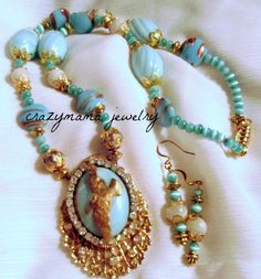 Handmade pendant on necklace of vintage blue glass beads, cats eye beads, gold tone findings earrings to match one of a kind $50.00 free shipping till Christmas