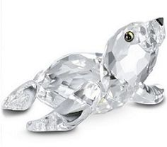 Swarovski Baby Sea Lion - Archived Data - This little Swarovski Baby Seal is so cute! Placed next to the Swarovski Mother Seal he looks so content. Swarovski Crystal Figurines, Swarovski Pearls, Cut Glass, Glass Art, Baby Sea Lion, Glass Animals, Water Animals, Crystal Collection, Clear Crystal
