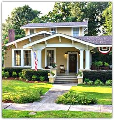 1925 Craftsman Cottage in Laurel, Mississippi  Hedges along foundation, nice.