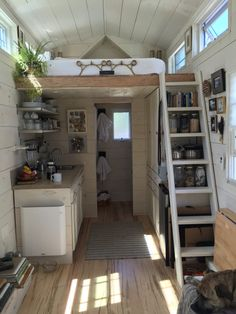 This good-looking tiny house on wheels is home to the Hall family – two adults, one child, and one dog. Read moreFamily of Three Makes Their Tiny Living Dream A Reality Small Tiny House, Tiny House Living, Tiny House Plans, Tiny House Design, Tiny House On Wheels, Small Living, Living Area, Tiny Cabins, Cabins And Cottages