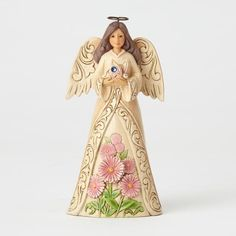 Monthly Angel figurine by Jim Shore for Heartwood Creek.Angel is 6.25, crafted of stone resin with the look and feel of handcarved woodRaised border and wing designs in rosemaling pattern, a trademark of Jim Shore'sIn her hand, the sparking, colored crystal birthstone of the monthOn her skirt, a colorful arrangement of the flower of the month in beautiful color and attention to detailSeptember, birthstone is sapphire, flower is asterCollectible birthstone birthday angel figurine or for gift-givi Rosemaling Pattern, Birthday Angel, February Birthday, Wings Design, Amethyst Crystal, Birthstones, Hand Carved, Aurora Sleeping Beauty, Beautiful