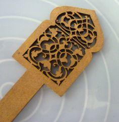 Moroccan  wooden window tassel  bookmark ,beaded mid turquoise art silk tassel. $7.00, via Etsy.