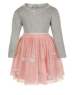 Add some glitz to her wardrobe with our disco bunny dress for baby girls. This 2-in-1 style features a grey sparkle jersey top decorated with beads and sequins, a shimmering waistband and a pink net skirt  with sequin bunnies. Pink and silver underskirts add extra volume.