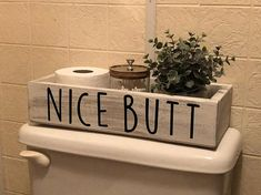 Perfect farmhouse bathroom decor! Made to fit on the top of a standard size toilet and perfect to hold your toilet paper and some small decor. This listing is for the Nice Butt wording. If you'd like yours without wording, please see the listing with no wording. If you'd like a #homedecorapartment