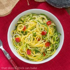 Today I'm featuring a riff on my sister's Zucchini Ribbons by spiralizing my summer squash and serving up these Zucchini Noodles with Parmesan!
