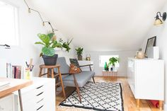 "A rug from <a href=""http://www.theanou.com/product/2111-black-white-pile-knot-rug"" target=""_blank"">The Anou</a> ties this little hideaway work area a little cozier."