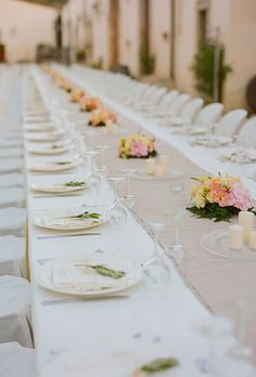 I like the simplicity of having the tables set with runners (if long tables) and little candles and flower centerpieces