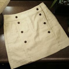 Tory Burch cream skirt Amazing fit. Great condition. Below the knee length Tory Burch Skirts