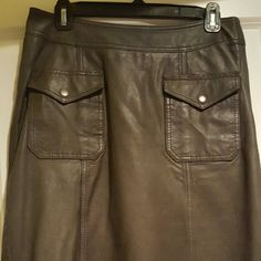 Leather skirt Dark green lamb leather skirt. Size large but fits more like a medium. Lucky Brand worn once, excellent condition. Lucky Brand Skirts Midi