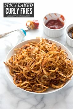 Spicy Baked Curly Fries made easily and quickly at home, are baked instead of fried. A spiralizer makes perfect curly fries that bake to perfection in a flash! Side Recipes, Veggie Recipes, Appetizer Recipes, Great Recipes, Snack Recipes, Dessert Recipes, Favorite Recipes, Healthy Recipes, Dinner Recipes