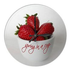 "this clock ""spring in a cup"" is perfect for a kitchen"