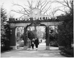 """Alumni Gateway with """"Campus Greetings"""" decorations during winter holidays, 1940s :: Ohio University Archives"""
