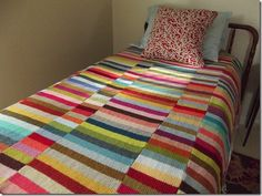 Idea: crocheting a bunch of striped scarves (basically) and then stitching them together to make a blanket like this!