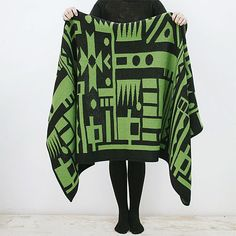 Green Geo Scarf Blanket. This full, warm and gorgeous knit can be used both as a scarf and as a blanket. $195