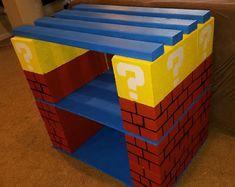Diy fish tank stand.  Using cinder blocks, plywood and 2x4s.  Mario themed.
