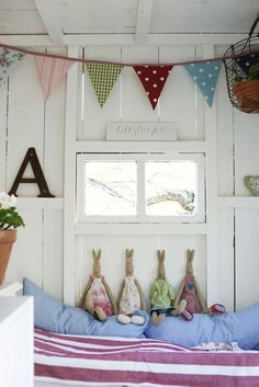 I really love the bright cheery colors, maileg bunnies, and bunting in this room for a child.