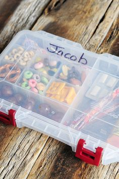 I seriously bet this would save me money in the summer....  Kids snack tackle box. Cute idea for older kids.