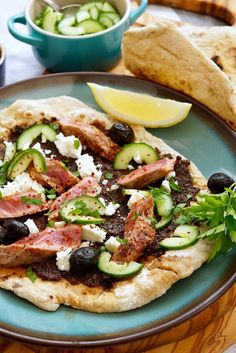 Seared lamb flatbreads with olive tapenade, feta and quick-pickled cucumber.