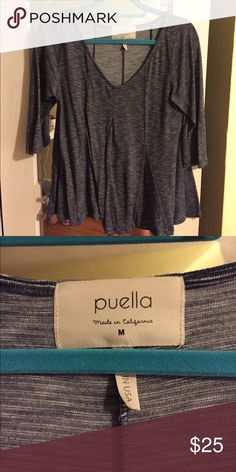 Anthropologie by Puella Blue Swing V Shirt Size M Very flattering fit, v does not go too low. Please ask questions if interested! If you know Puella, you know their clothing is incredibly soft. This one is no exception. It is blue with very fine white lines on it. It has cool tapering at the bottom to make it flowy and forgiving - a great top! Anthropologie Tops Tees - Short Sleeve