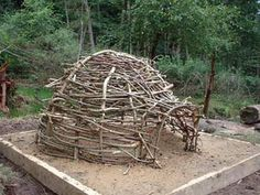 earth oven framed with sticks. Once covered you can burn the frame out.