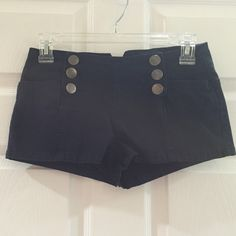Navy blue shorts Navy blue shorts with silver buttons down both sides in front and buckle in back. 97% cotton 3% spandex. These run like a 0. The back buckle can be adjusted. The model wearing them is a 00 2.1 denim  Shorts Jean Shorts