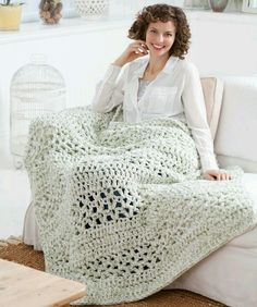 4 stands crochet at once - love big chunky blankets! You can find pattern on Red Heart project LW2739