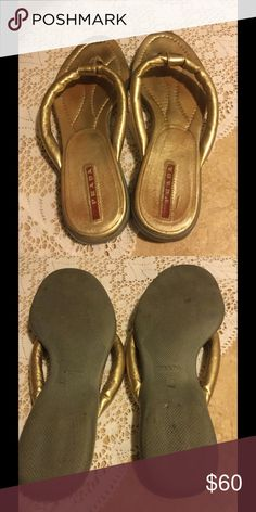Gold Prada Flip Flop Sandals Really cute metallic gold Prada flip flops. In really nice condition. The gold isn't worn at all. The bottoms are consistent with gentle wearing. The size isn't marked but they fit me and I wear a 7.5. Prada Shoes Sandals