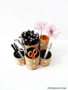A great do-it-yourself can desk organizers tutorial using tin cans and some cork to soften up the edges. Decorate with polka dots and youre on your way!