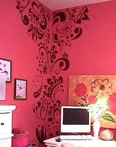 stenciled wall in corner of teen bedroom