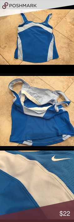 Nike spot top with build in bra Women's / S Used but excellent condition blue and white color. Nike Tops