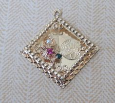 A vintage 14kt Yellow Gold Happy Anniversary charm from the 60s--very cute. It even has a bouquet of flowers built into the design. It tips the