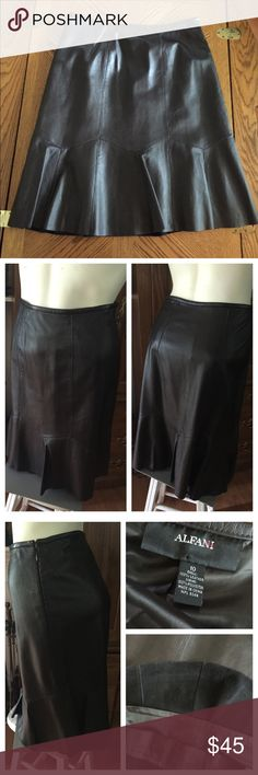 """Soft-as-Butter Brown Leather Skirt ~ ALFANI LOVE this soft-as-butter, fully lined ALFANI Brown leather Skirt ~ Size 10. 100% polyester black lining. Gored bottom (made of shaped pieces sewn together so that it is fitted at the waist and flared at the bottom). Zips and hooks on the side. Measured flat across (so double): waist 15""""; hips 20""""; length 23"""". In excellent preowned condition with NO issues. Smoke-free home. Alfani Skirts Midi"""