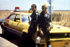 On duty- Max and Goose w/ Max's Interceptor