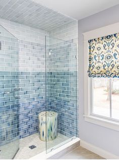 Your shower can be a spa-like space with the right tile. This shower features seamless glass door that opens to a walk-in shower clad in blue ombre ceramic tiles alongside a cream and blue stool placed atop a cream tiled shower floor. Design by ACQUIRE Glass Tile Shower, Blue Glass Tile, Shower Floor, Bathroom Showers, Tile Showers, Glass Tiles, Bad Inspiration, Bathroom Inspiration, Bathroom Ideas