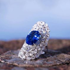 Boghossian. Oval-shaped Sapphire and Diamonds Ring.