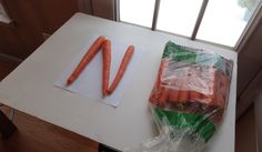 Winter is a great time to make food alphabets near the window or door - snow helps make great light for photos!