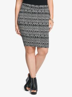 "It's time to MINI-mize things! This casual black and ivory skirt has a short, sexy attitude. It's a curve-hugging, contemporary silhouette finished with an on-trend ikat and skull print. A fold-over waistband puts the finishing touch on this hot style.<br><br><b>Model is 5'9.5"", size 1</b>"