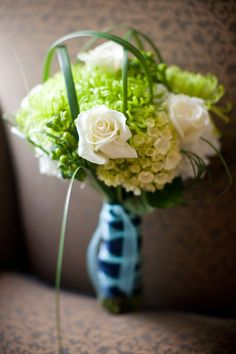 Green and white hydrangea and roses.