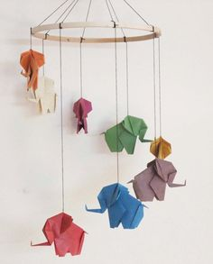 "This colorful origami mobile is made from handmade banana paper. 8 unique and colorful elephants are hand folded from 9"" square units. These hang"