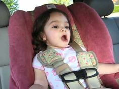 """In this adorable video from 2010, a 2-year-old girl named Penelope does an awesome job of signing along to the Pearl Jam song """"Elderly Woman Behind The Counter in a Small Town"""" from the back seat of her parent's car."""
