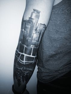 minneapolis skyline, reflected forest tattoo back of arm