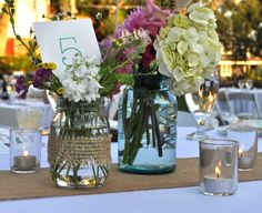 "center piece table arrangements, obsessed with the rustic mason jar look! Loving the turquoise jars, as turquoise is one of ""our"" colors"