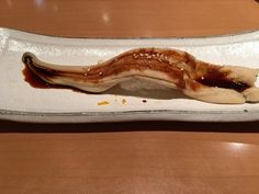 #tempting One long strip of anago eel with sweet soy sauce from Tsukiji Tamasushi in #tokyo #japan - #imenehunes #food #yum #delicious #longstrip #anagoeel #eel #sweetsoysauce #tsukijitamasushi #longstripofanagoeelwithsweetsoysauce #visittokyo #visitjapan