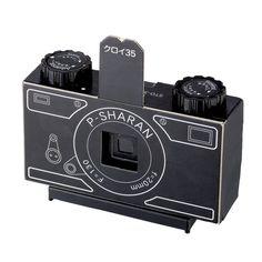 DIY PINHOLE CAMERA - Deepen your understanding of the 35mm with this STD-35e. This DIY pinhole camera rocks an innovative light-tight clamshell design. Made in Japan, it features durable, 1mm-thick black cardboard with plastic advance and rewind spools. The Sharan STD-35e pinhole kit has complete illustrated instructions for easy assembly (and amazing results). It's the perfect activity for shutterbugs to focus on.