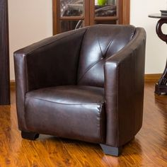 The Dale club chair bears resemblance to the World War II bomber seat. With its wide stance, brown leather upholstery and padded backrest, this chair exudes classic style for modern day appeal.