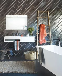 It& no secret that we LOVE subway tile here at ABM. It& fresh, inexpensive and classic. In the past I have stuck with a traditional offset pattern for all of my subway tile. Bathroom Wall Tile, Subway Tiles Bathroom, Diy Bathroom Decor, Subway Tile Patterns, Small Bathroom Makeover, Black Subway Tiles, Bathroom Makeover, Subway Tile Design, Tile Design