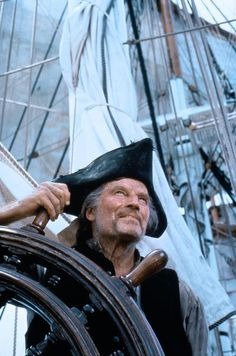 "Long John Silver played by Charlton Heston in ""Treasure Island"" (1999) based on the novel of the same title by Robert Louis Stevenson."
